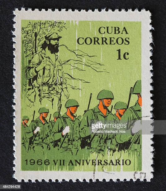 Cuban 1 cent stamp depicting soldiers walking in line and a revolutionary Cuba Correos VII Aniversario 1966 The stamp marks the 7th anniversary of...