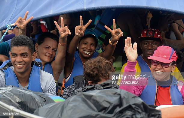 Cuban and Haitian migrants travel on a vessel to Capurgana in the Caribbean Gulf of Uraba in northwestern Colombia to illegally cross to Panama...