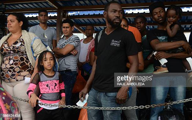 Cuban and Haitian migrants wait before boarding a vessel to Capurgana in the Caribbean Gulf of Uraba in northwestern Colombia to illegally cross to...