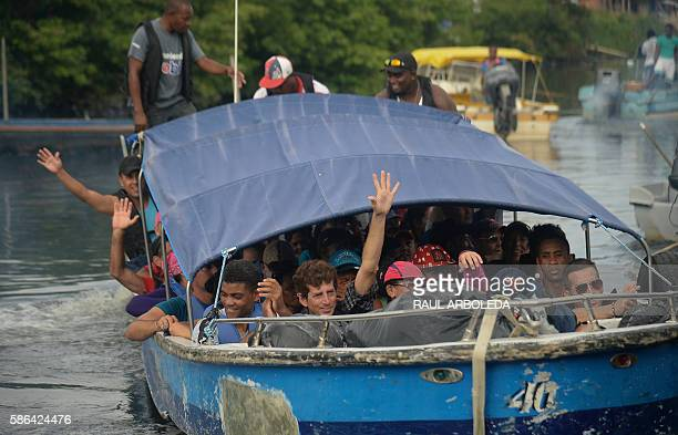 Cuban and Haitians migrants get into a boat to be taken from Turbo to Capurgana both in the Caribbean Gulf of Uraba in northwestern Colombia to...