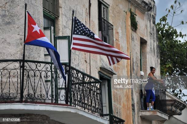 Cuban and US flags are seen on balconies in Havana on March 20 2016 On Sunday Obama became the first US president in 88 years to visit Cuba touching...