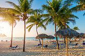 Cuban beach with sun lounger and palms, Varadero, Cuba