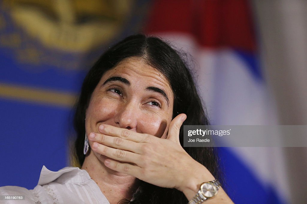 Cuban blogger and independent journalist <a gi-track='captionPersonalityLinkClicked' href=/galleries/search?phrase=Yoani+Sanchez&family=editorial&specificpeople=5329857 ng-click='$event.stopPropagation()'>Yoani Sanchez</a> participates in an event at the Miami Dade College's Freedom Tower on April 1, 2013 in Miami, Florida. Sanchez's visit to Miami, the heart of the Cuban exile community, happens as she takes part in a world tour to speak about life in Cuba.