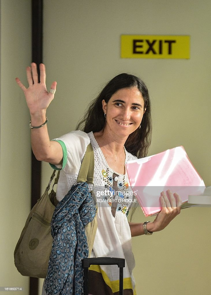 Cuban blogger Yoani Sanchez says goodbye to her family upon departing from Havana's airport on February 17, 2013. Sanchez will visit Brazil, which will be her first stop on a foreign tour. During her stay in that country, the blogger will attend the opening of Brazilian filmmaker Dado Galvao's 2009 documentary 'Connection Cuba-Honduras,' in which she is interviewed.