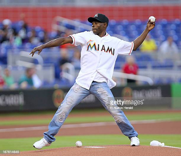 Cuban boxer Guillermo Rigondeaux throws the ceremonial first pitch before the Miami Marlins play host to the Chicago Cubs at Marlins Park in Miami...