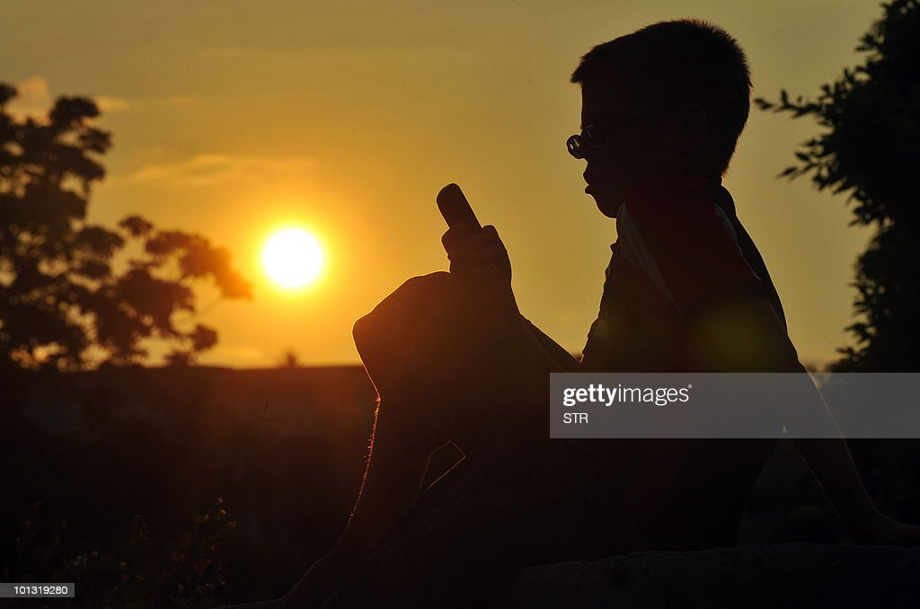 A Cuban boy uses his mobile phone on June 1, 2010 in Havana.