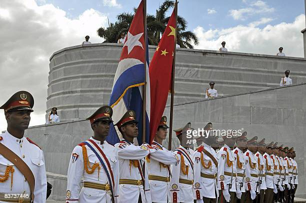 Cuban cadets pay honour to Chinese President Hu Jintao during a ceremony at the Jose Marti Monument in Havana's Revolution Square on November 18 2008...