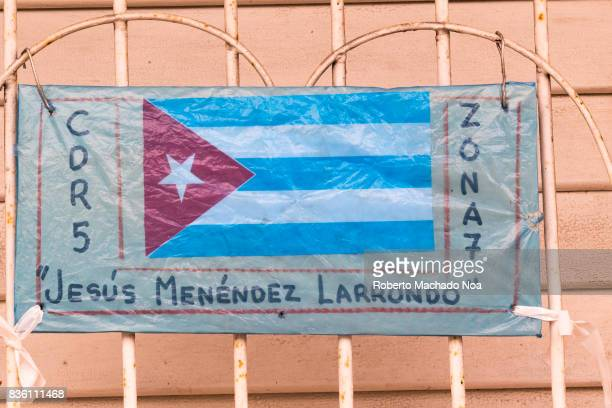 Cuban CDR sign Polythene banner with Cuban National Flag and Spanish text tied on iron grill in a private house