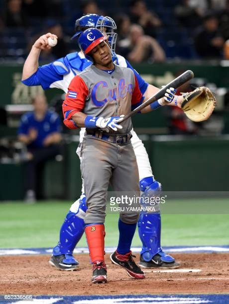 Cuban center fielder Roel Santos reacts after A strikeout at the top of the eighth inning during the World Baseball Classic Pool E second round match...