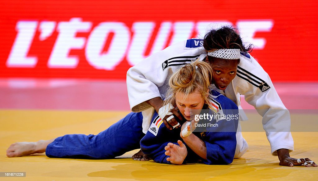 Cuban champion, Marinet Espinosa of Cuba (white), lost her u63kgs repercharge match to Martyna Trajdos of Germany by an ippon during the Paris Grand Slam on day 1, Saturday, February 09, 2013 at the Palais Omnisports de Paris, Bercy, Paris, France.