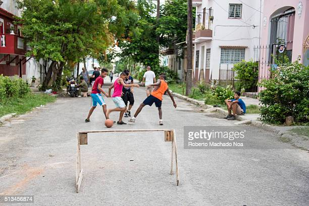 Cuban children simple lifestyle Boys playing street soccer football