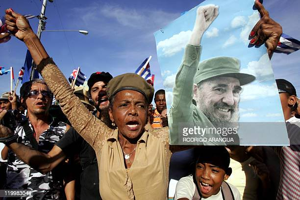 Cuban citizens cheers as they attend 02 December 2006 at Revolution Square in Havana a military parade celebrating the 50th Anniversary of the...