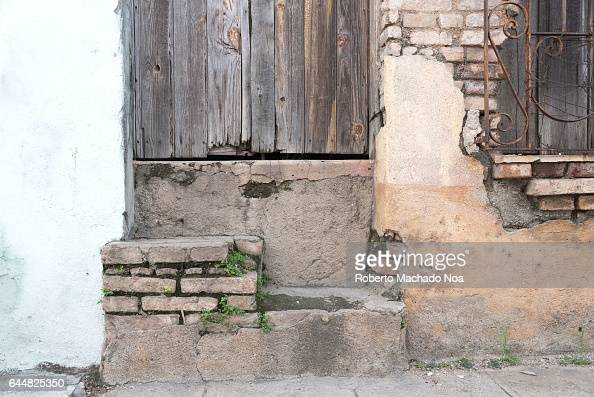 Cuban colonial architecture details Weathered doorstep entrance of a house Economic hardship has forced many people to keep their property without...