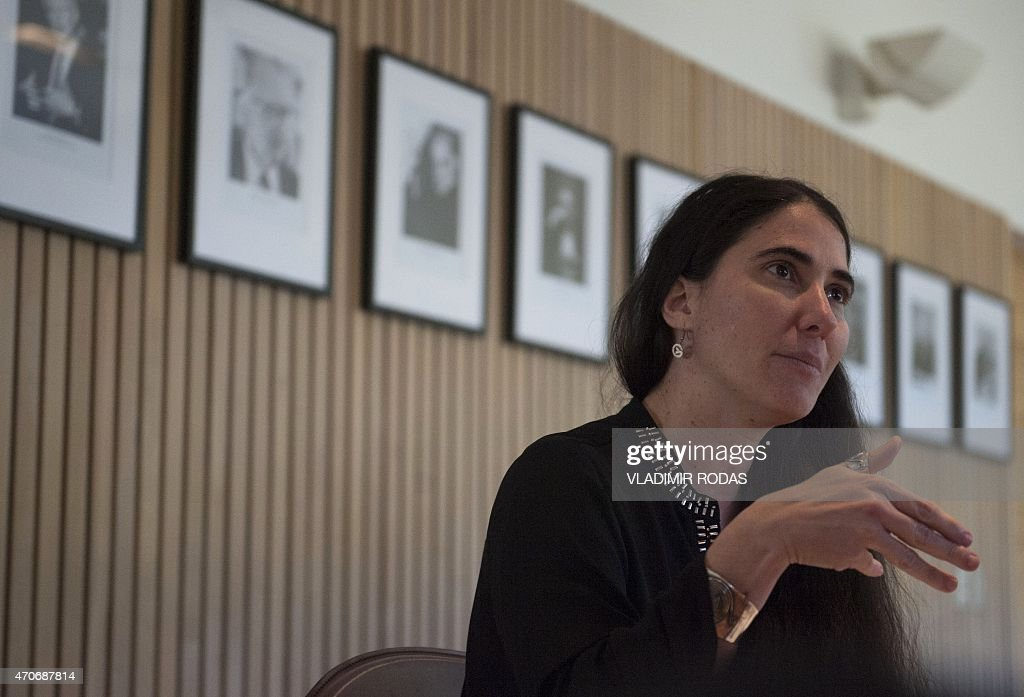 Cuban dissident blogger Yoani Sanchez offers a press conference in Santiago, on April 22, 2015. During her visit to Chile, Sanchez addressed a crowd at the Adolfo Ibañez University, where she gave her perspective about Cuba and talked about her life as a blogger. AFP PHOTO / Vladimir Rodas