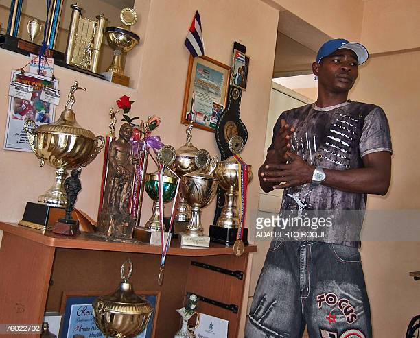 Cuban double Olympic and world bantamweight champion Guillermo Rigondeaux speaks with the press at his house in Havana 08 August 2007 Rigondeaux and...