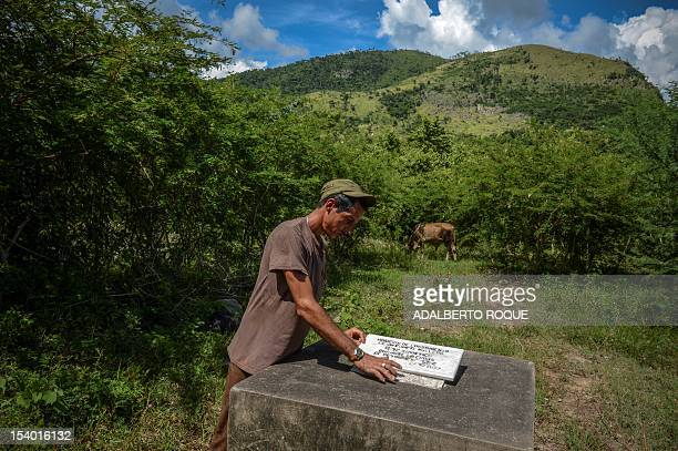 Cuban farmer Alexis Teston cleans a marble plaque marking the place where a Russian R12 theatre missile was deployed during the 1962 missile crisis...