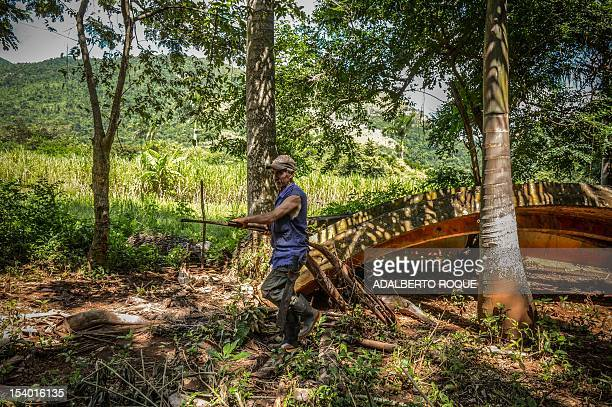 Cuban farmer Jose Teston cleans the ruins at the site of a Russian R12 theatre missile silo built during the 1962 missile crisis in San Cristobal...