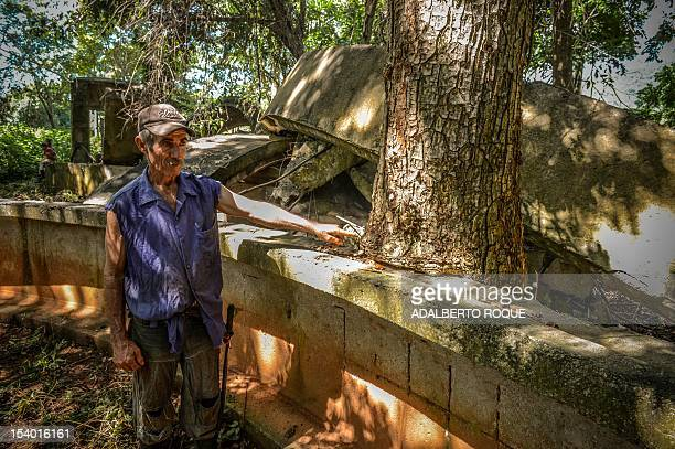 Cuban farmer Jose Teston points at a tree that grew in the site of a Russian R12 theatre missile silo built during the 1962 missile crisis in San...