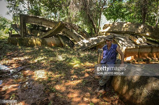Cuban farmer Jose Teston rests on a concrete wall built during the 1962 missile crisis at the site of a Russian R12 theatre missile silo in San...