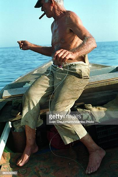 Cuban fisherman Felix holds the fishing line during a fishing trip offshore the little fishermen village Cojimar on June 13 in Havana Cuba The...