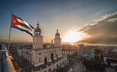 Cuban flag over Plaza de la Cathedral at sunset, Santiago de Cuba, Cuba