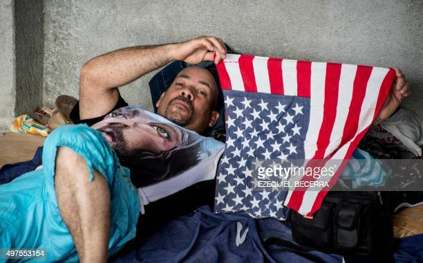 A Cuban from a group of 150 resting in a shelter in the town of La Cru Guanacaste Costa Rica near the border with Nicaragua holds a US flag on...