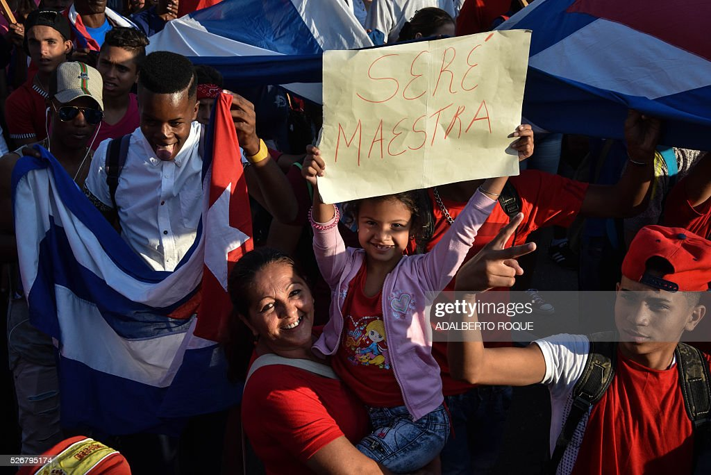 A Cuban girl displays a sign reading 'I'll Be a Teacher' during the May Day parade in Havana, on May 1, 2016. / AFP / ADALBERTO