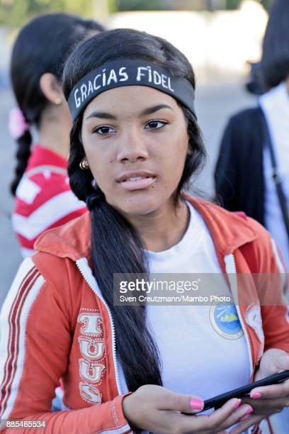 Cuban girls wears a bandana that reads Gracias Fidel prior to a march from the Revolution square to the Santa Ifigenia cemetery as Cuba commemorates...