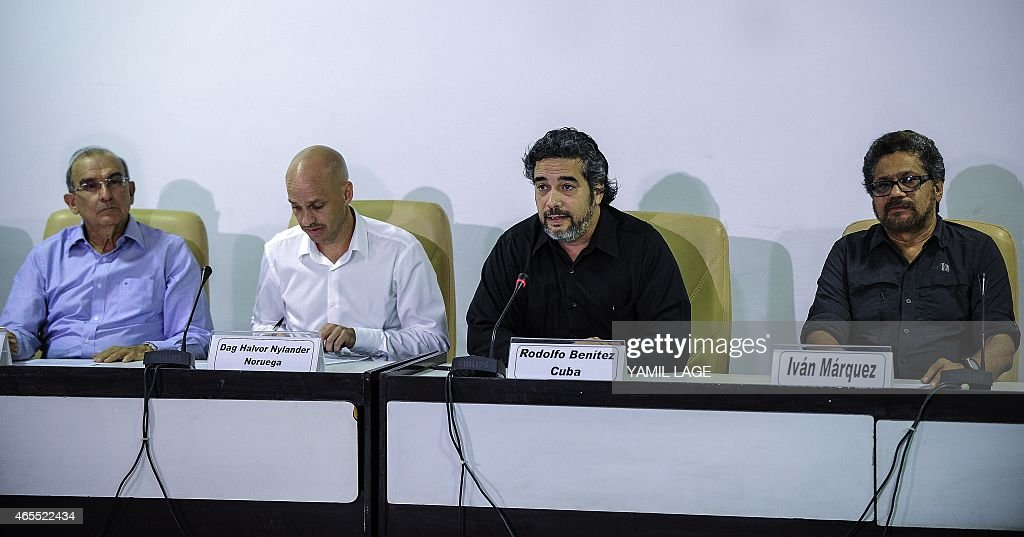 Cuban guarantor Rodolfo Benitez (2-R) speaks during a press conference at the Convention Palace in Havana, on March 7, 2014, next to Humberto de la Calle (L), head of the Colombian delegation for peace talks, Norwegian guarantor Dag Nylander (2-L) and Commander Ivan Marquez (R), leader of the FARC delegation. AFP PHOTO/Yamil LAGE