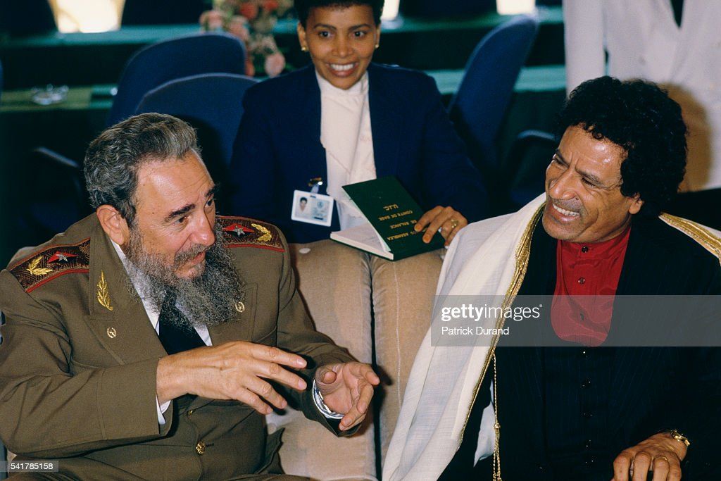 Cuban Head of State since 1976 Fidel Castro and Libyan Statesman Moammar Kadhafi at the eighth Summit of NonAligned Countries Driven by the need to...