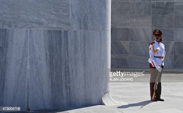 A Cuban honor guard stands during a wreath laying ceremony at the 'Jose Marti' Memorial in Revolution Square in Havana on May 11 during French...