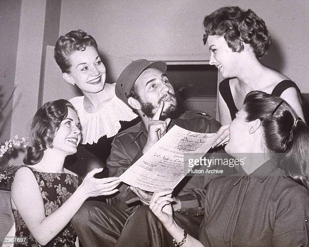 Cuban leader Fidel Castro is presented with an invitation to the New York Press Photographer's Ball New York City April 23 1959