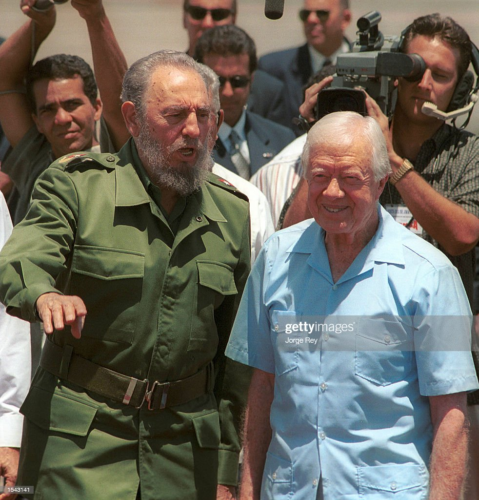 Cuban leader Fidel Castro speaks with the former US President Jimmy Carter during a departure ceremony at Jose Marti International airport May 17...