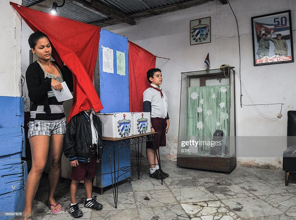 A Cuban leaves the booth after casting her vote at a polling station in Havana on February 3, 2013. Cubans on Sunday elected provincial delegates to to the People's Power assemblies and parliamentary deputies.