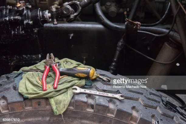Cuban lifestyle: Tools of mechanic over wheel in diesel truck being repaired in the street