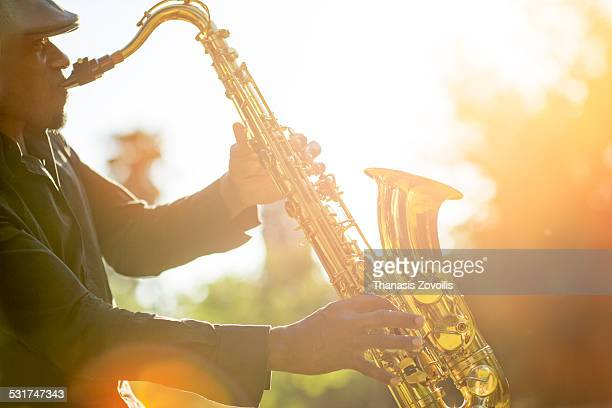 Cuban man playing saxophone outdoor