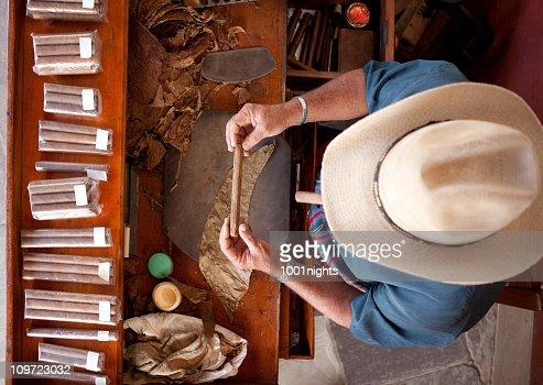 Cuban man rolling cigar