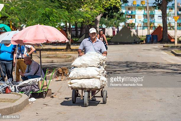 Cuban man transporting sacks of aluminum cans Government recycles aluminum and pay decently to private operator who collect the cans