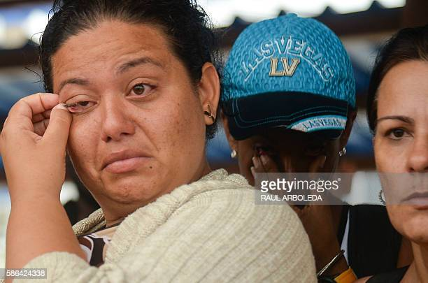 Cuban migrant cries before boarding a vessel to Capurgana in the Caribbean Gulf of Uraba in northwestern Colombia to illegally cross to Panama...