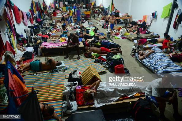 Cuban migrants rest in a shelter in the Turbo municipality Antioquia department Colombia on June 14 2016 More tan 500 Cuban migrants are in Panama...