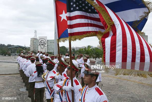 Cuban military color guard carrying a Cuban flag and an American flag wait for the arrival of US President Barack Obama before he attends a wreath...
