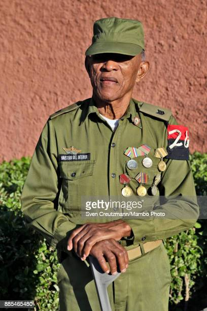 Cuban military official watches a march to honor late Revolution leader Fidel Castro as Cuba commemorates the first anniversary of Castros funeral on...