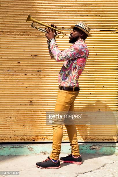Cuban musician playing trumpet in Havana