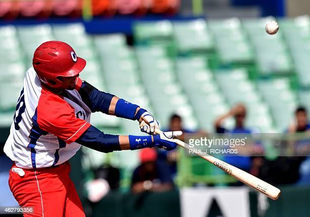 Cuban National baseball infielder Yulieski Gurriel hits the ball in the 5th inning against the Venezuela National baseball team during the Serie Del...