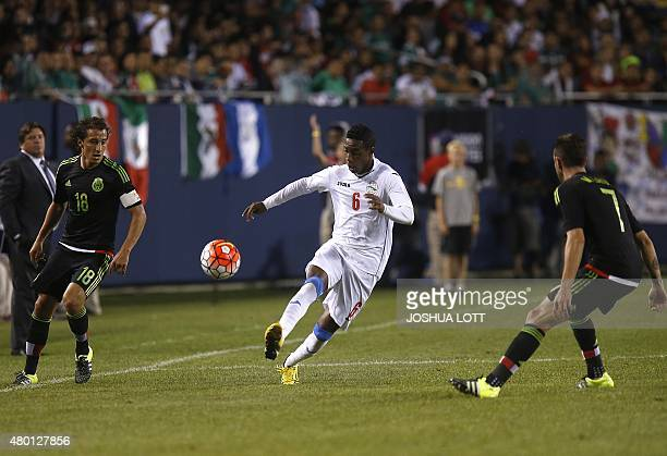 Cuban National Team defender Yaisnier Napoles controls the ball between Mexican National Team midfielder Antonio Rios and defender Miguel Layun...