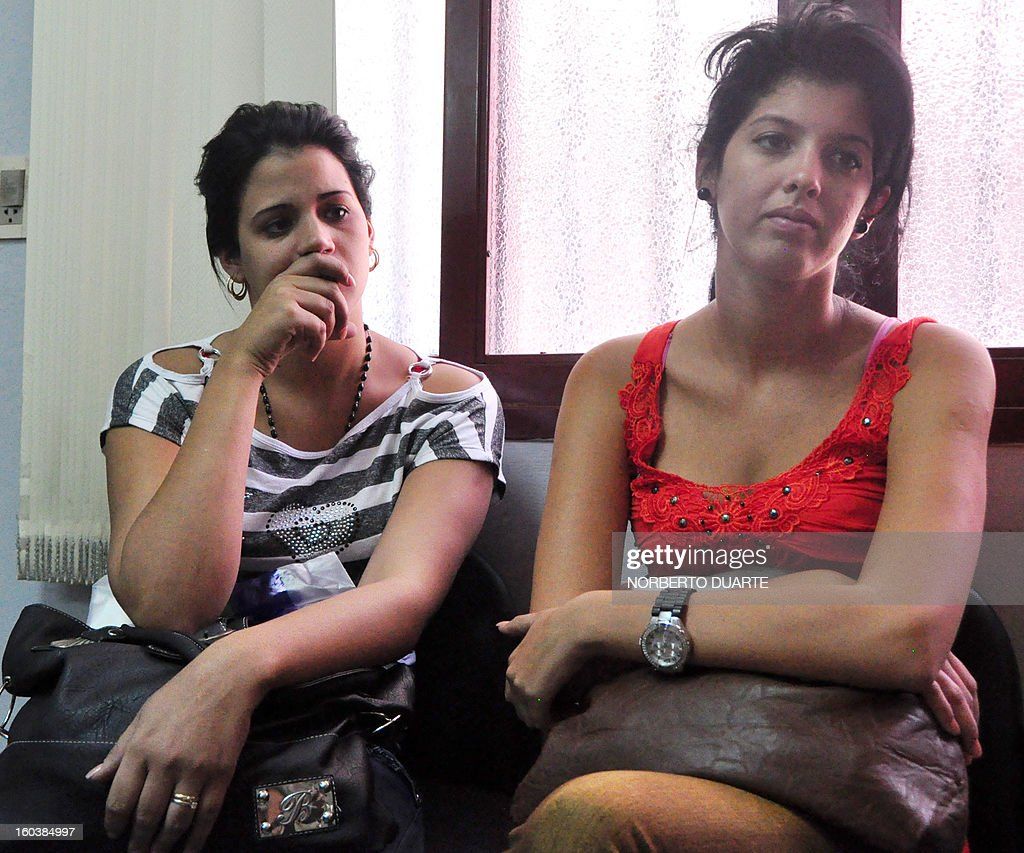Cuban nationals Lisandra Infiesto Rodriguez (L) and Katherine Acosta Piedra, arrested upon attempting to enter the country with forged passports, await to declare at the prosecutor's office in Luque, Paraguay, on January 30, 2013. Both women were arrested on Monday at Asuncion's international airport after having been expelled from San Salvador. Their lawyer said that their goal is to go to the United States and that in terms of avoiding deportation to Cuba, his clients will request political asylum.