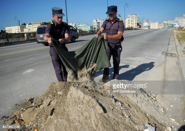 Cuban Navy personnel work cleaning a street days after the passage of Hurricane Irma in Havana on September 15 2017 Hit harder than expected by...