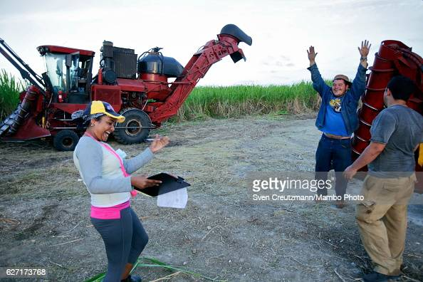 Cuban operator of a harvest machine cheers after he was informed that he broke a harvest record for the brigade he is working for during the zafra...