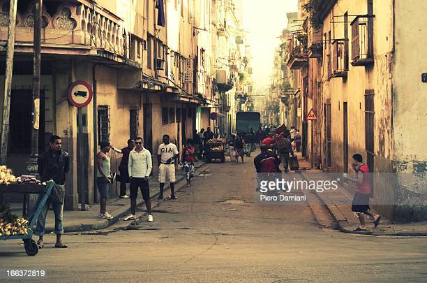 CONTENT] Cuban people going about their daily life during a hazy morning in one of Havana busy streets