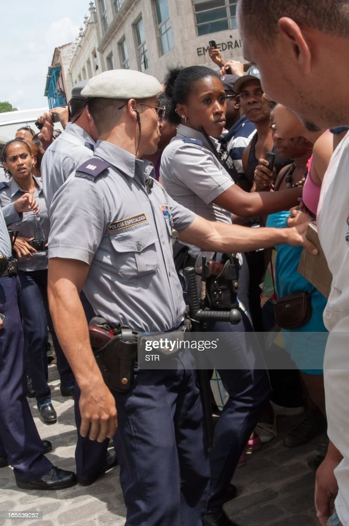 Cuban police stop people than want to see Beyonce during a visit of the US singer to Havana, on April 4, 2013.
